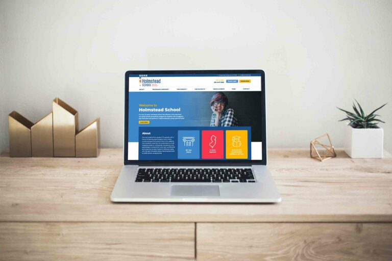 holmstead-website-on-laptop